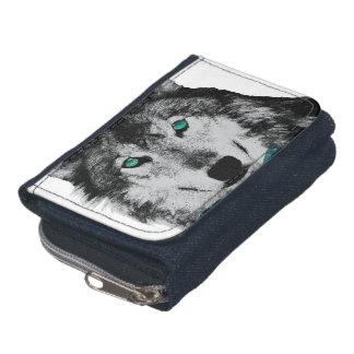 Lobo con ojos azules y una pajarita