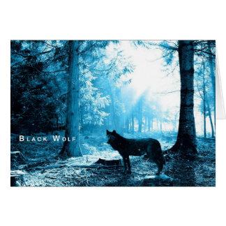 Lobo negro solamente en el bosque tarjeta pequeña