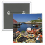 Lobster pots, buoys, and ropes on the dock at pinback button