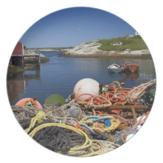 Lobster pots, buoys, and ropes on the dock at dinner plates