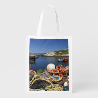Lobster pots, buoys, and ropes on the dock at reusable grocery bags