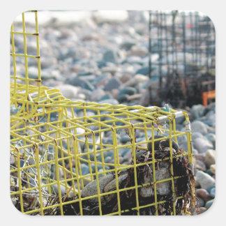 Lobster Traps on Rocky Beach Square Sticker