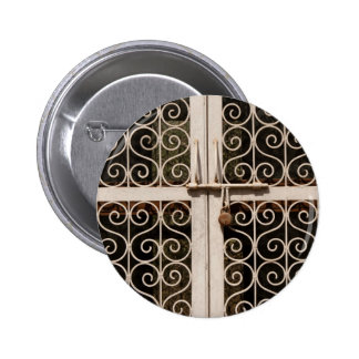 Locked metal gate with patterns pinback buttons