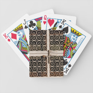 Locked metal gate with patterns poker cards
