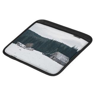 Log cabin in the snow iPad sleeves
