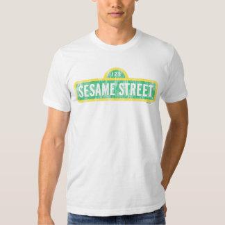Logotipo amarillo de la muestra del Sesame Street Poleras