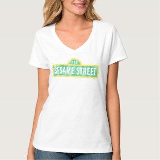 Logotipo amarillo de la muestra del Sesame Street Remeras