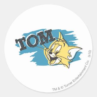 Logotipo azul y amarillo de Tom Pegatina Redonda