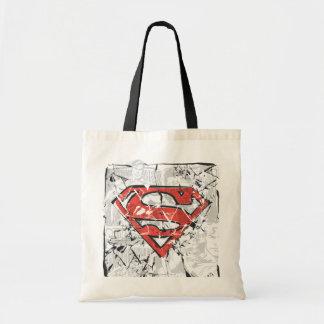 Logotipo cómico arrugado del superhombre bolsas