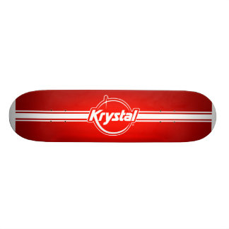 Logotipo de Krystal con el monopatín de la tira Skate Boards