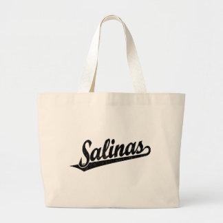 Logotipo de la escritura de las salinas en el negr bolsas lienzo