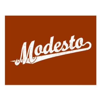 Logotipo de la escritura de Modesto en el blanco a Postales