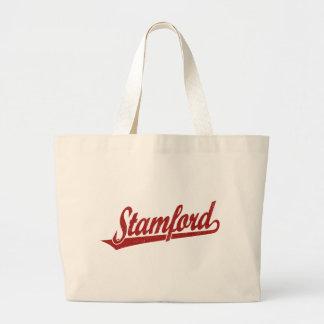 Logotipo de la escritura de Stamford en el rojo ap Bolsas