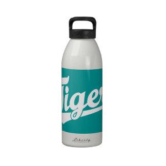 Logotipo de la escritura del tigre en blanco botellas de beber