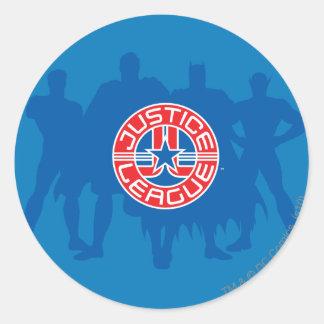 Logotipo de la liga de justicia y fondo sólido del pegatina redonda