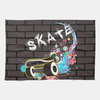 Logotipo de la pintada del patín de la pared de toallas de cocina