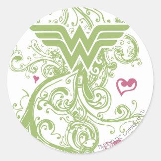 Logotipo de los remolinos del verde de la Mujer Pegatina Redonda