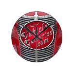 logotipo de VehicleGalleries.com en parrilla del v Relojes De Pared