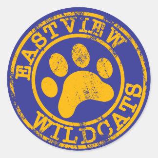 Logotipo del amarillo del pegatina de los gatos