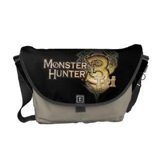 Logotipo del cazador del monstruo tri bolsas de mensajeria