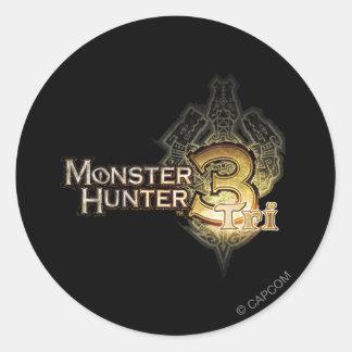 Logotipo del cazador del monstruo tri pegatina redonda