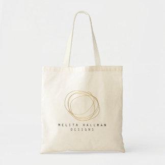 Logotipo del garabato del diseñador en el oro bolsa tela barata