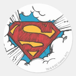 Logotipo del superhombre en nubes pegatina redonda