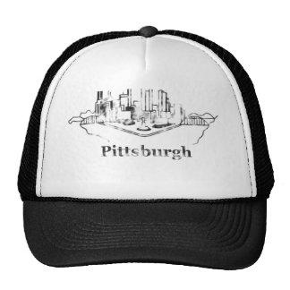 Logotipo descolorado del horizonte de la ciudad de gorras de camionero