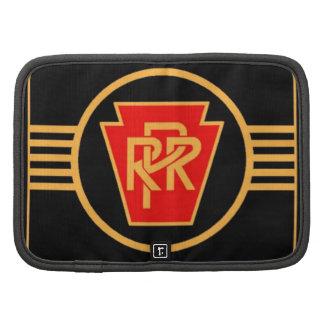 Logotipo, negro y oro del ferrocarril de Pennsylva Planificador