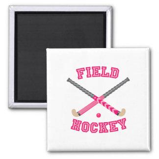 Logotipo rosado del hockey hierba imán para frigorífico
