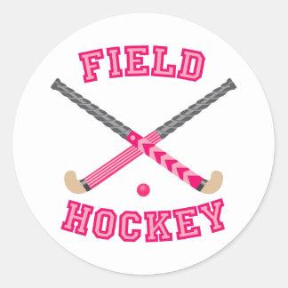 Logotipo rosado del hockey hierba pegatina redonda