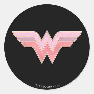 Logotipo rosado y anaranjado de la Mujer Maravilla Pegatina Redonda