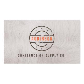 Logotipo sellado rústico en la construcción gris d tarjetas de visita