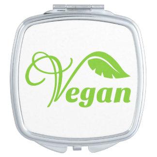 Logotipo verde del vegano espejos maquillaje