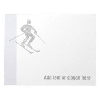 Logotipo y lema del esquiador blocs de papel
