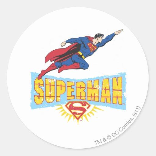 Logotipo y vuelo del superhombre etiquetas redondas