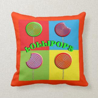 Lollipops brillantemente coloreados del caramelo cojín