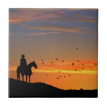 """Lone Cowboy Art Tile<br><div class=""""desc"""">A great western piece,  this features a lone cowboy in a southwestern sunset.</div>"""
