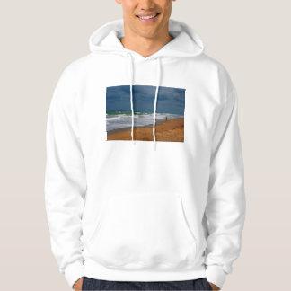 Lone Man Walking on Stormy Beach Sweatshirts
