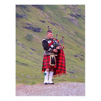 Lone Scottish bagpiper, Highlands, Scotland Postcard