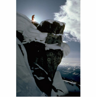 Lone snow skier on top of large rock edge Winter Photo Cutout