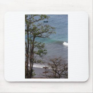 Lone surfer on tropical paradise beach mouse pad