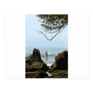 Lone surfer tranquility surfing postcard
