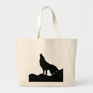Lone Wolf Standing on a Hill Canvas Bags
