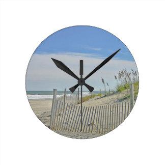 lonely beach round wall clocks