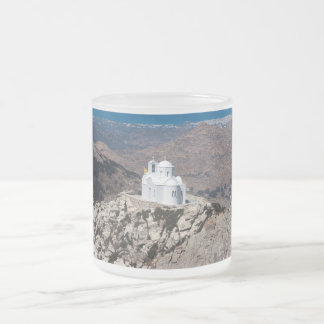 Lonely church in Greek mountains Frosted Glass Coffee Mug