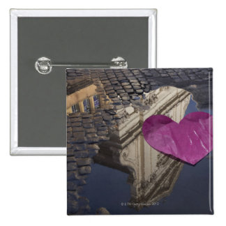 Lonely paper heart floating in a puddle. pins