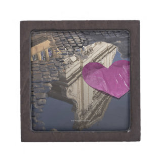 Lonely paper heart floating in a puddle. gift box