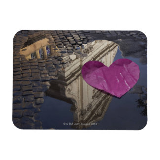 Lonely paper heart floating in a puddle. magnet