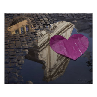 Lonely paper heart floating in a puddle. poster